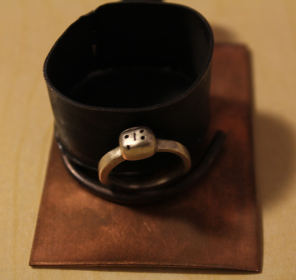 ladybug silver ring on copper burner with frying pan and copper display